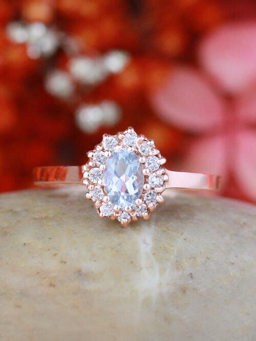 Oval Aquamarine and Floral Patterned Halo Diamond Engagement Ring