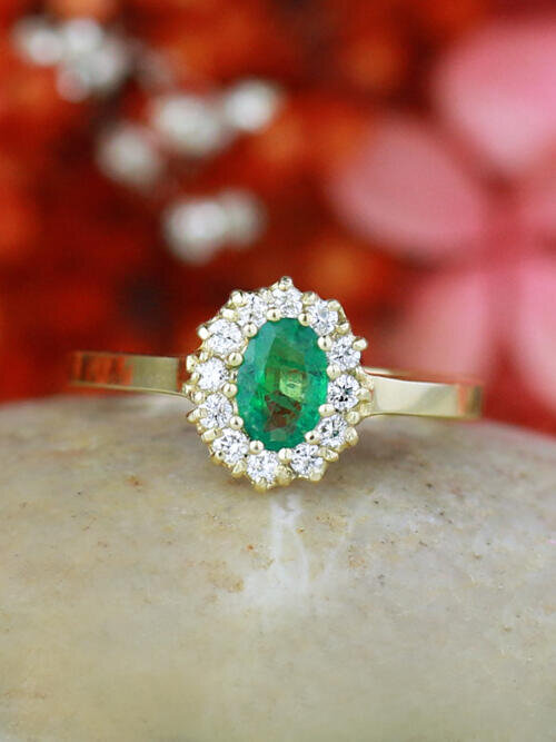 Oval Emerald with Floral Patterned Halo 14 Karat Engagement Ring