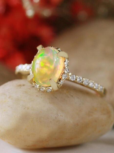 Oval Ethiopian Opal 14 Karat Gold Engagement Ring