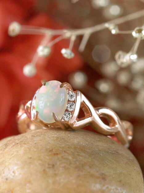 Oval Opal Goddess Ring with Diamonds and Twist Design 14 Karat Engagement Ring