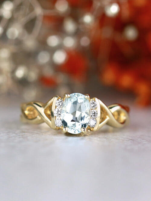 Oval Aquamarine Goddess Ring with Diamonds and Twist Design 14 Karat Engagement Ring