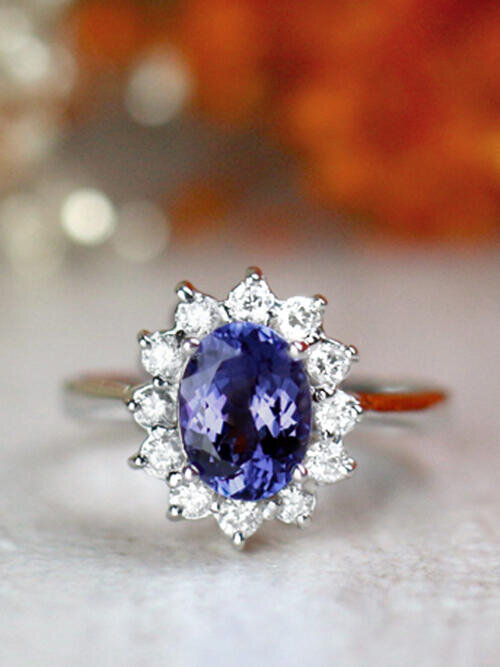 8x6MM Oval Tanzanite and Diamond Halo Solid 14 Karat Gold Cocktail Ring
